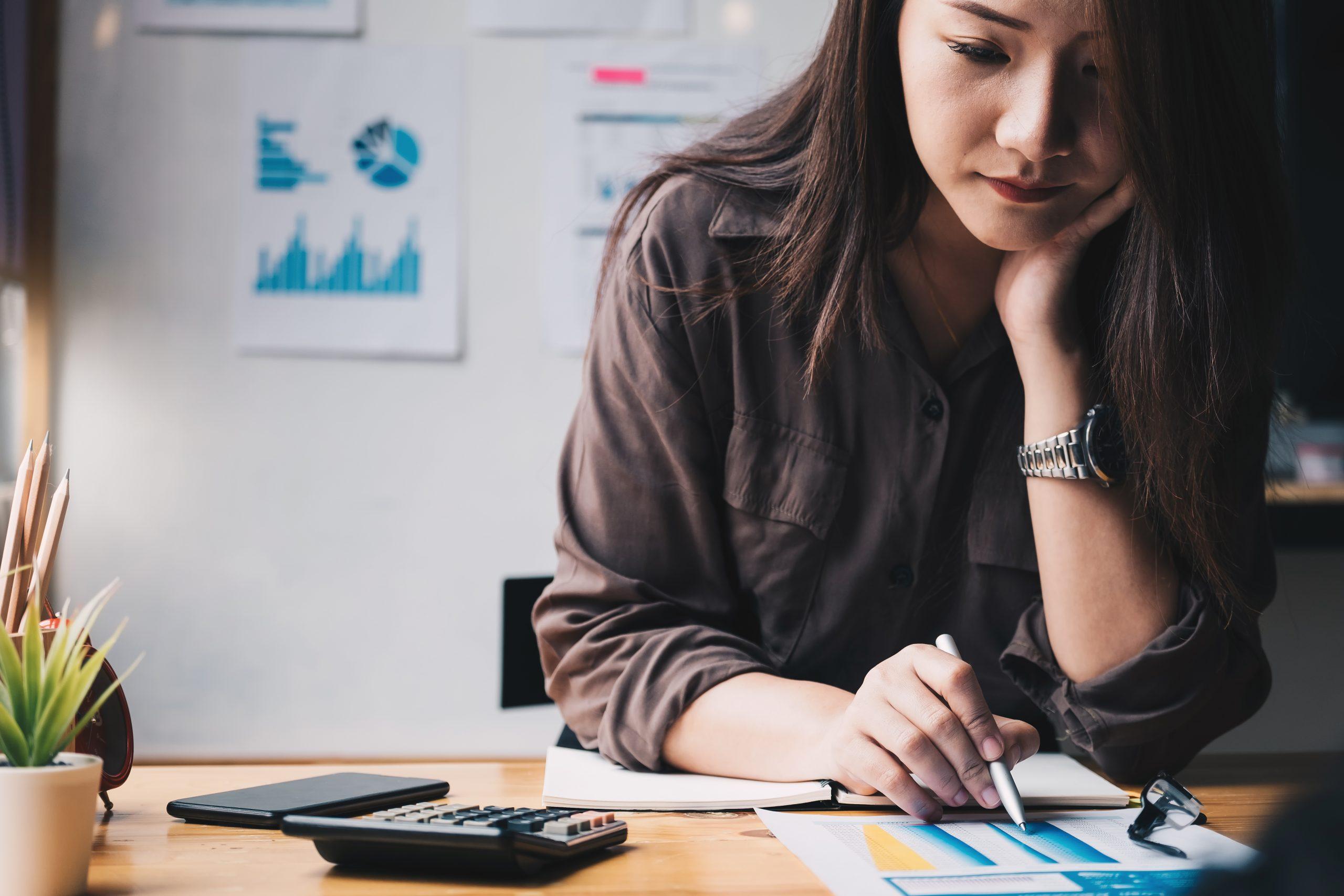 Aviatrix Accountancy - Tax - VAT returns - Woman looking over figures with calculator