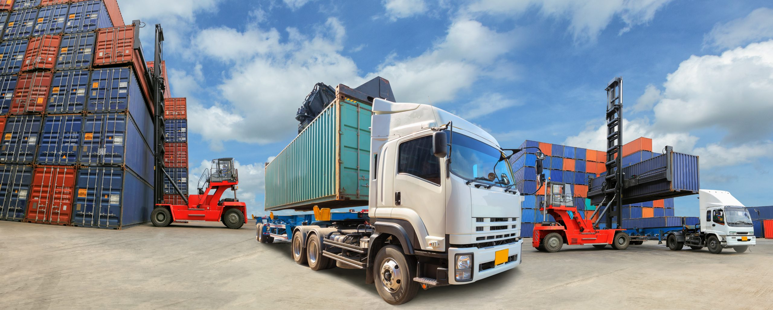 Aviatrix Accountancy - Transport and Logistics - Truck with Industrial Container Cargo for Logistic Import Export at yard.